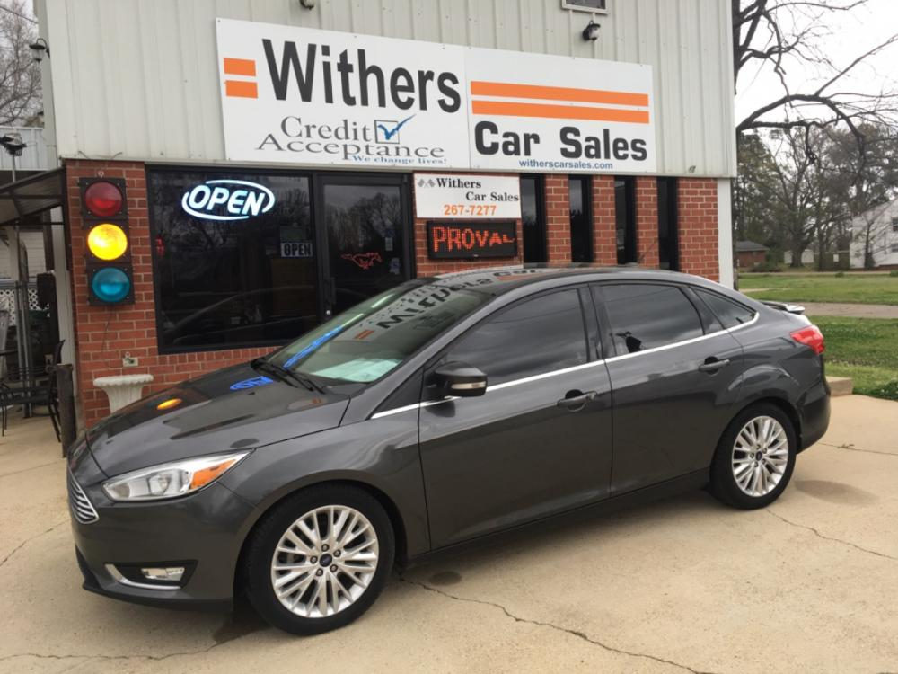 2016 GRAY /BLACK LEATHER Ford Focus Titanium Sedan (1FADP3J20GL) with an 2.0L L4 DOHC 16V engine, 6A transmission, located at 204 Hwy. 16 East, Carthage, MS, 39051, (601) 267-7277, 32.734486, -89.531761 - Photo #0