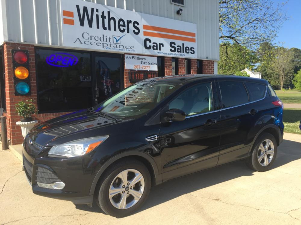 2016 Black /Gray Ford Escape SE FWD (1FMCU0G76GU) with an 2.5L L4 DOHC 16V engine, 6-Speed Automatic transmission, located at 204 Hwy. 16 East, Carthage, 39051, (601) 267-7277, 32.734486, -89.531761 - Photo #0